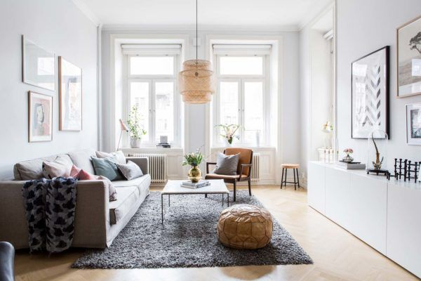 Bright and airy two-bedroom Scandinavian apartment interior .