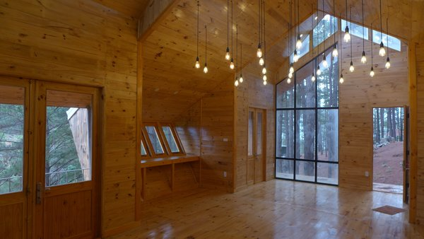 Photo 2 of 10 in These Geometric Cabins Glow Like Lanterns in a .