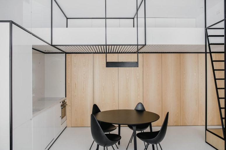 Modern Apartment Tied Up With Black Framing - DigsDi