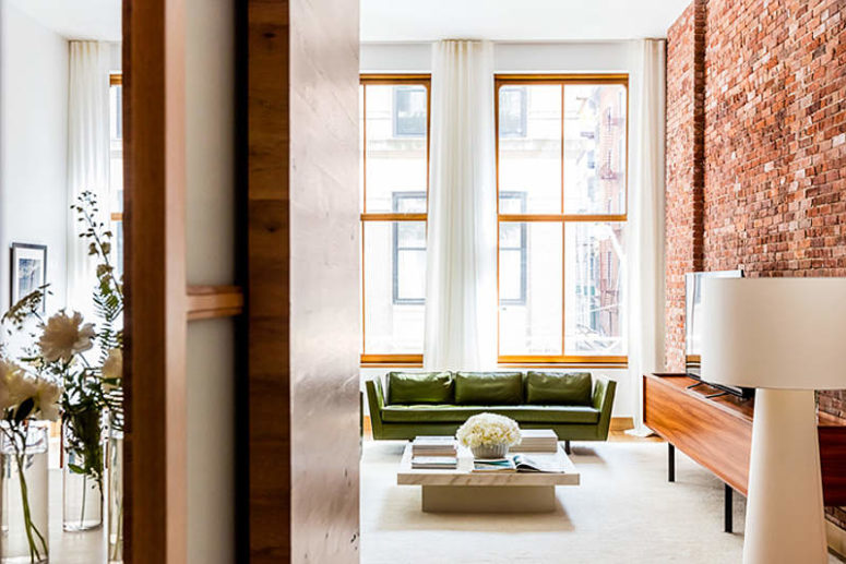 Spacious Apartment With Exposed Brick And Marble In Decor - DigsDi