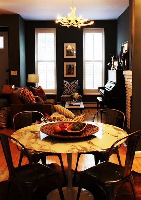 Love the marble top table and dark walls   Nyc apartment .