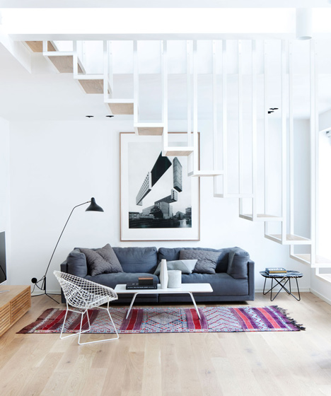 Floating steel staircase divides Idunsgate Apartment by Hapt