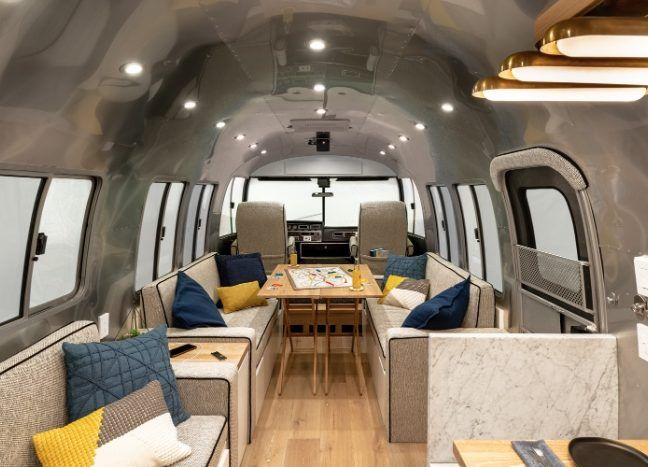 Customized Airstream camper fits seven with room to spare for pop .
