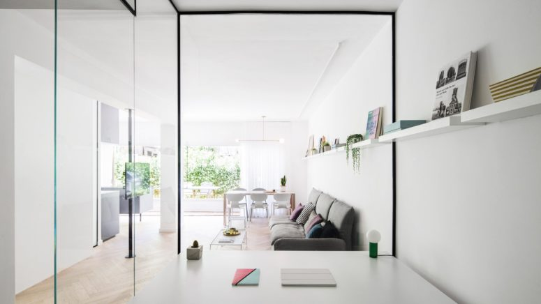 Airy And Light-Filled Apartment With Glass Walls And Brass Touches .
