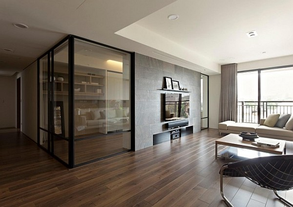 Modern apartment with retractable glass walls for home office ar