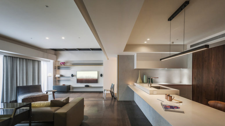 Modern Apartment Inspired By The Owners' Hobbies - DigsDi