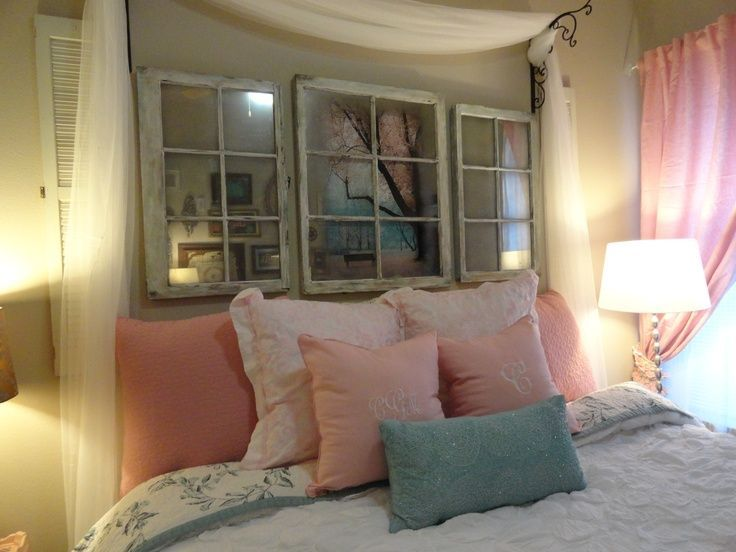 It would be cute to hang mirrors on our main living room wall .