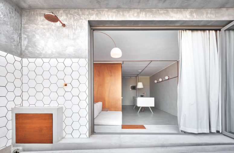 Minimalist Apartment Done With Concrete And Copper Pipes - DigsDi