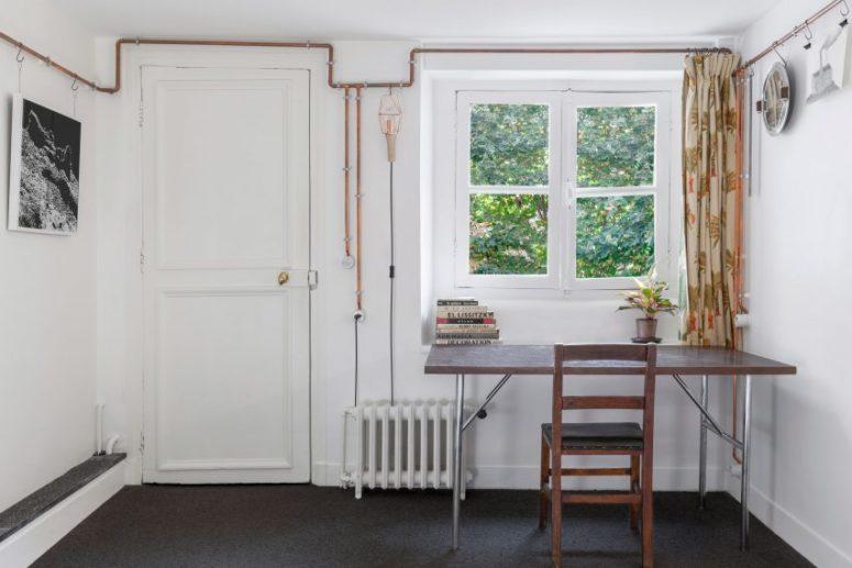 Small Studio Apartment With Copper Pipe Detailing - DigsDi