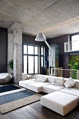 Raw cement look giving this living area an industrial feel. www .