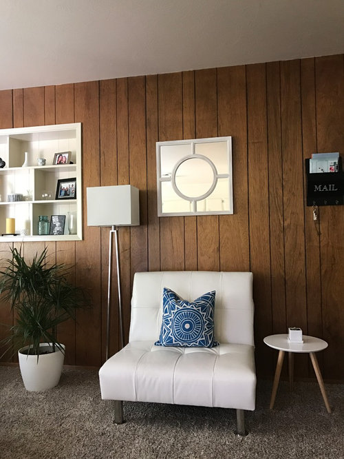 Ugly 70s wood paneling in our outdated apartmen