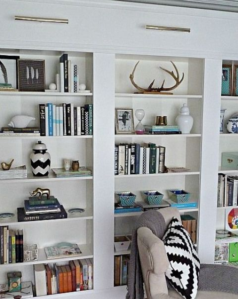You can make a bunch of Billy bookcases look like a real built-in .