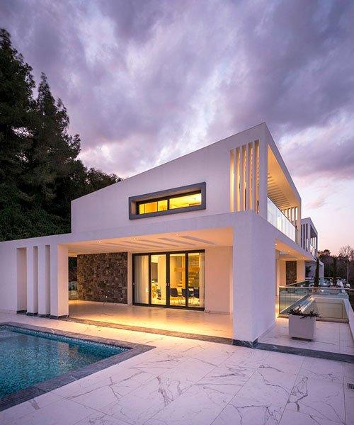 officetwentyfivearchitects designs two idyllic beachside villas in .