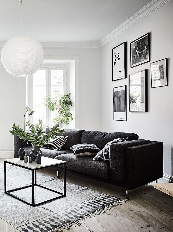 Living room in black, white and gray with nice Gallery wall .