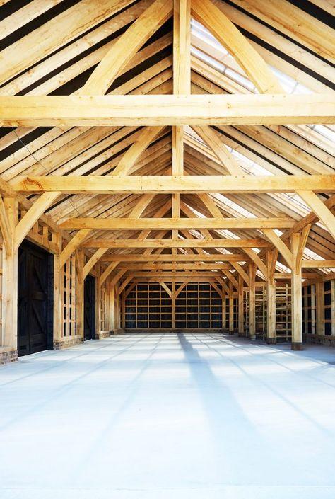 Black barn built by Macdonald Wright at Caring Wood country house .