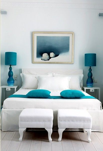White sheets donned with splashes of teal. Check out the coastal .