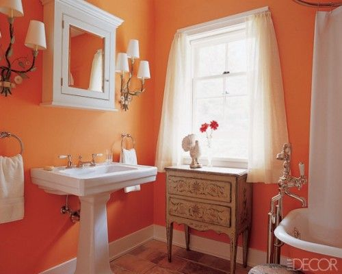 I once had a bathroom this orange. It sure does wake you up in the .