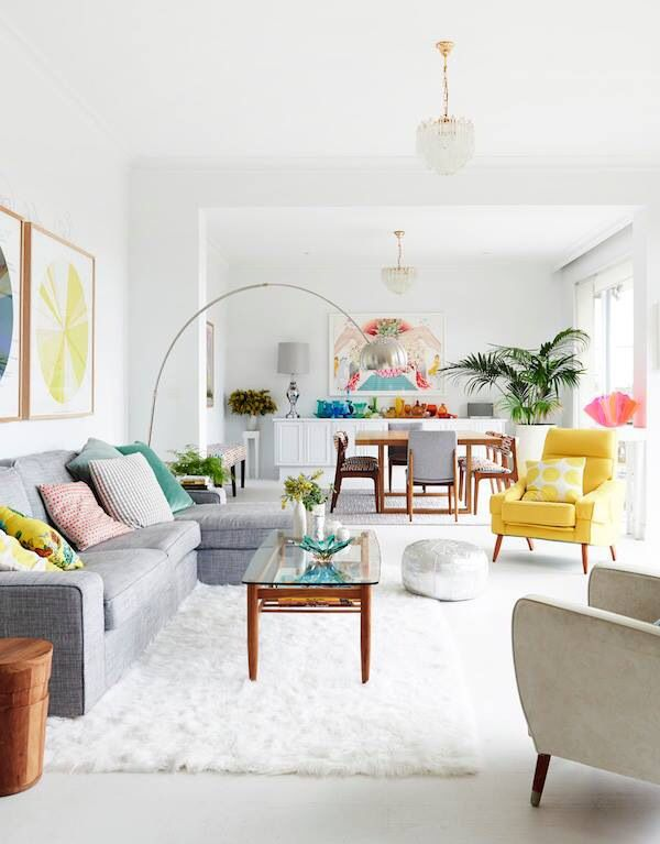 12 Hacks to Make Your Home Look More Luxe   Bright living room .