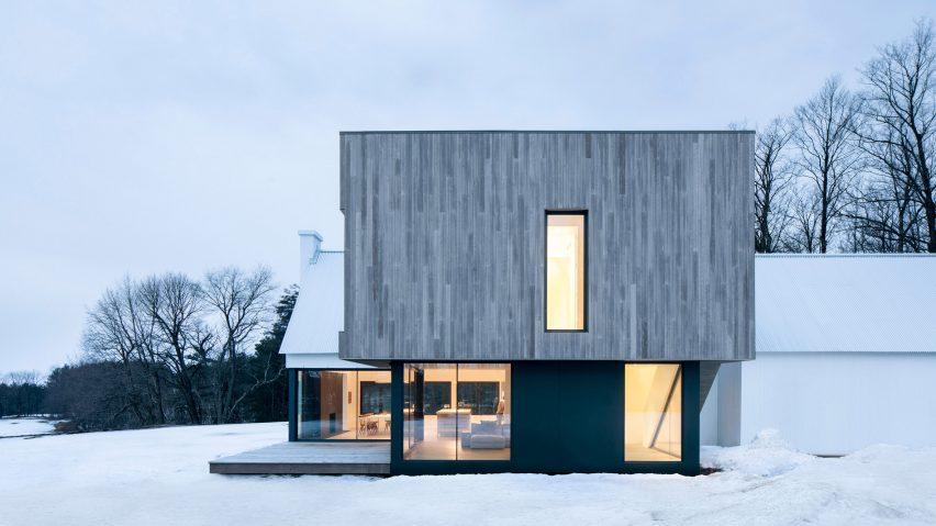 TBA adds cedar-clad extension to white farmhouse in Queb