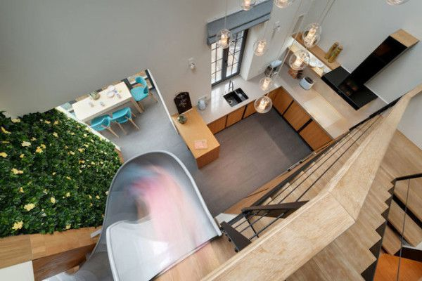 An Apartment With An Indoor Slide Is Living Life To The Fullest .