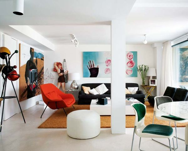 A minimalist white décor complemented by bold colors and striking .
