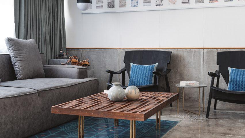 Sāransh combines concrete, blue tiles and teak inside MD Apartme