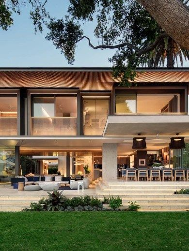 Contemporary family dwelling nestled on the Sydney Harbour shore .