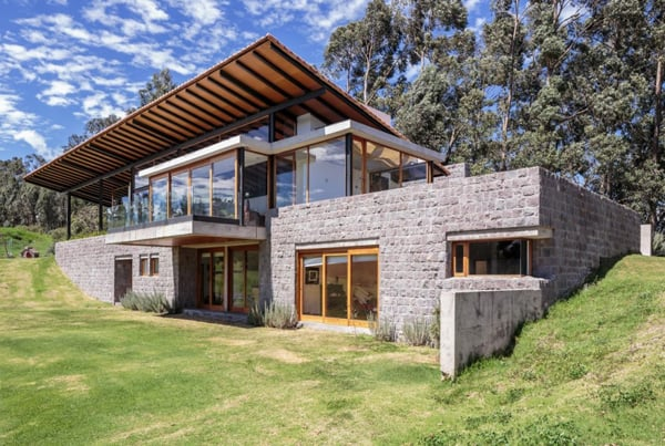 Glass and stone modern residence with views of the Ecuadorian .