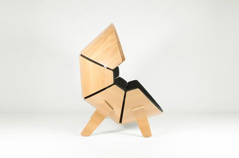 think & shift forms molded plywood hideaway chair for children .