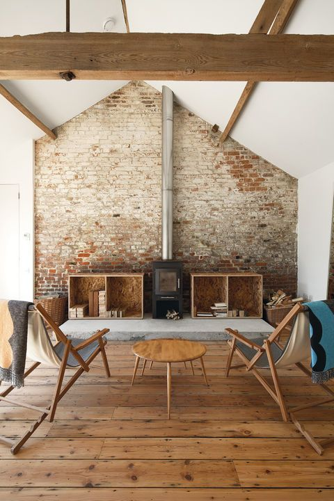 Loving the amount of reclaimed wood used in this modern farmhouse .