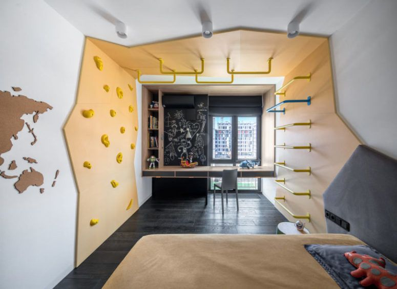 The second kid's room is similar, also done in grey and bright .