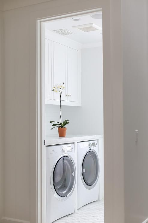 White Laundry Room with Electrolux Washer and Dryer - Cottage .