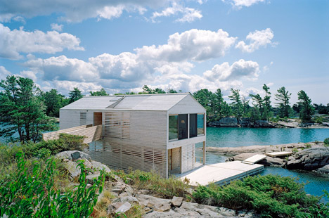 Floating House bobs on the surface of Canada's Lake Hur