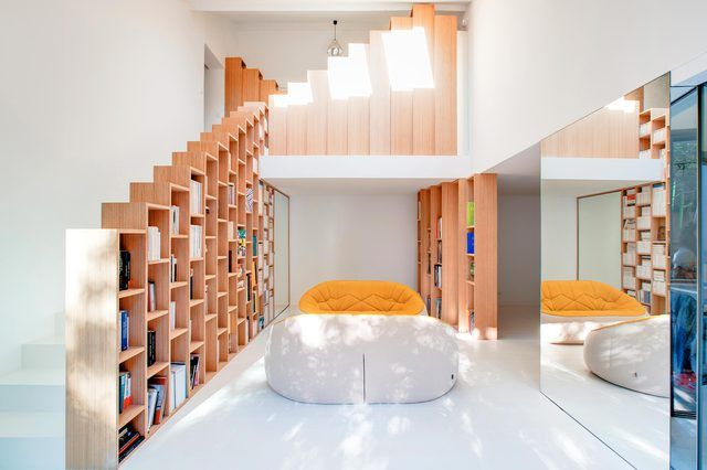 A Renovated Home in the Paris Suburbs Is a Bibliophile's Dream .