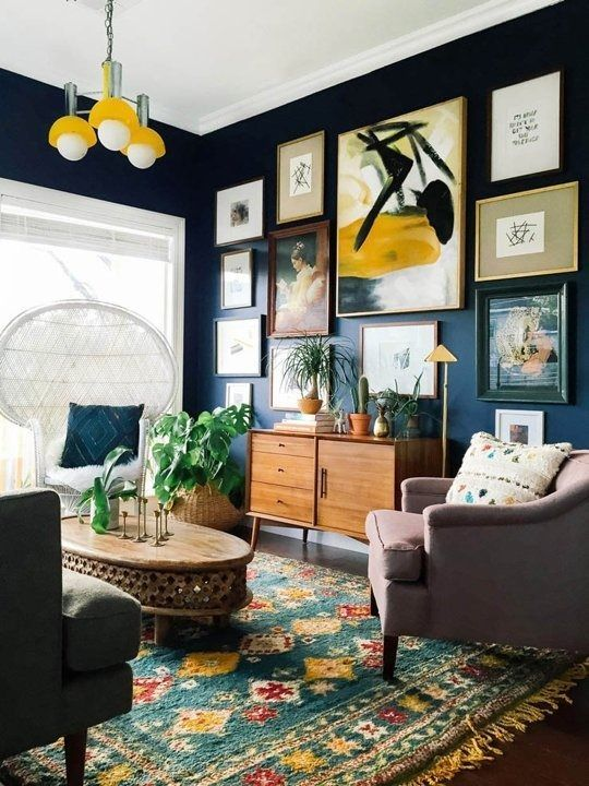 Create a large gallery wall on dark paint to lower intensity in .