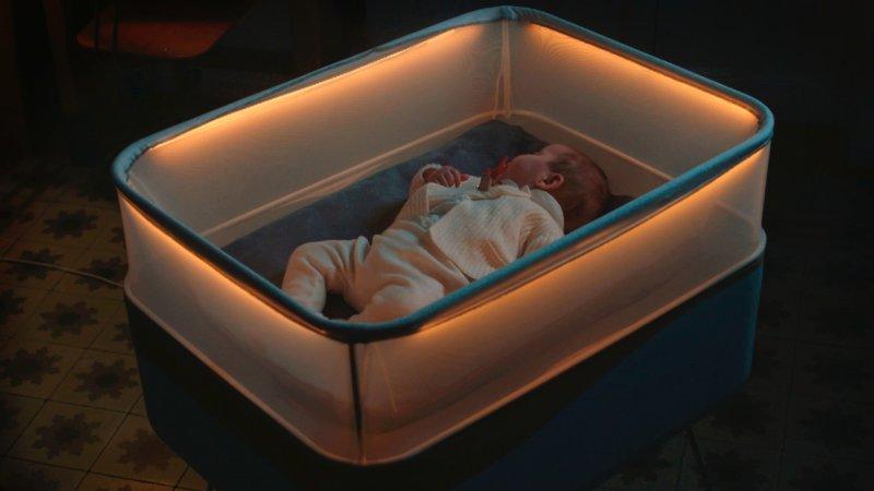Ford smart crib rocks babies to sleep using car sounds .