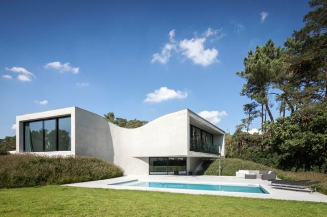 Villa MQ With Unique Sloping Architecture - DigsDi