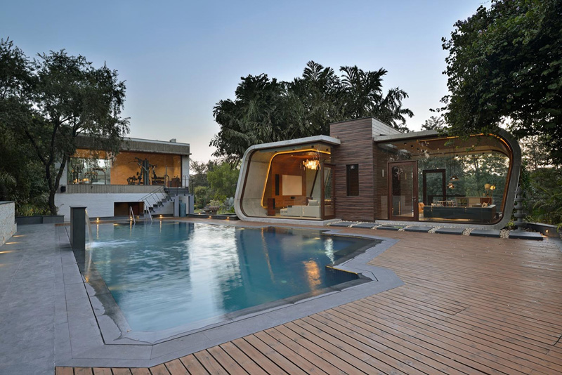 This pool house was built with a curved concrete she