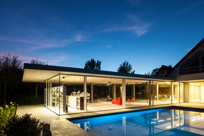 Impressive Design of a Modern Glass and Concrete Pool House in .