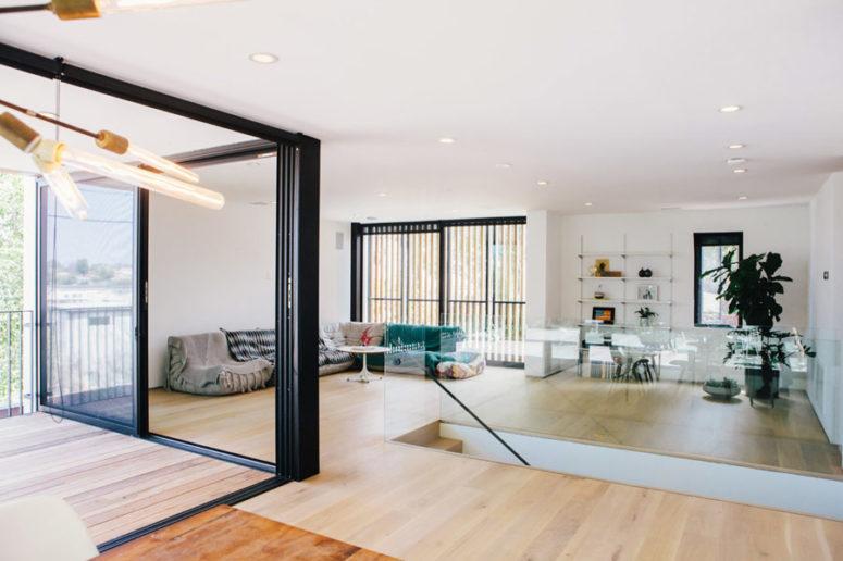 Minimalist Family Home With Glazed Walls - DigsDi