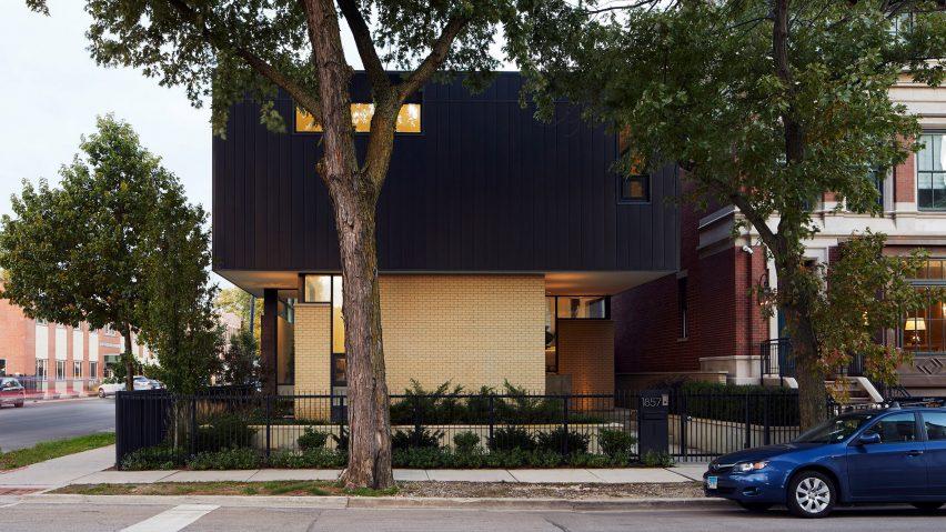 Studio Dwell stacks black volume onto brick to form top-heavy .