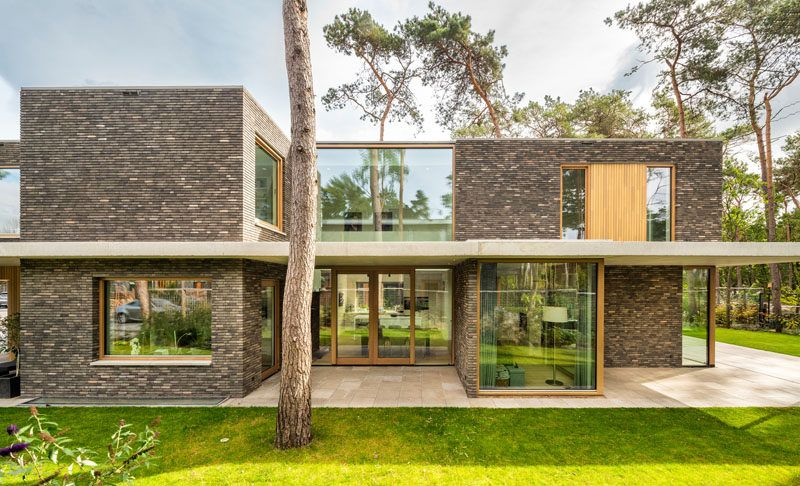 The exterior of this modern house features brick volumes that are .