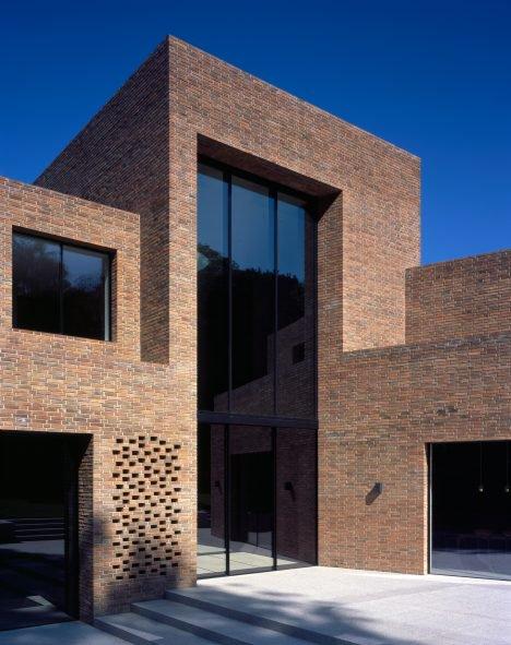 Trio of brick volumes form Highgate House by Carmody Groarke .