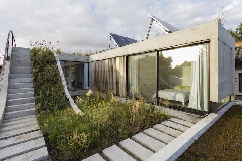 Eco-Friendly House Built Around A Vertical Gard