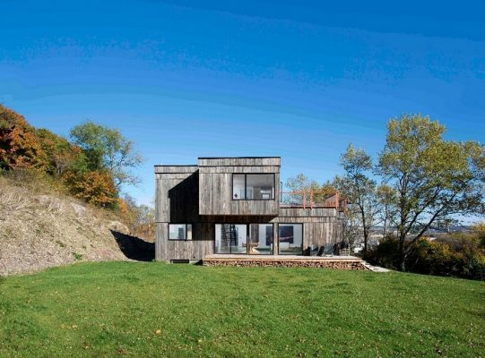 Into the Wild House is Clad in Weathered Wood with Accent on the .