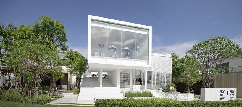 the sky clubhouse features a white gradient façade to filter the .