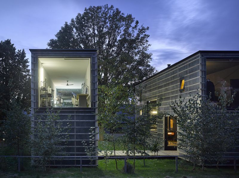 A Zen House Divided In Two Separate Volumes Linked By A Brid