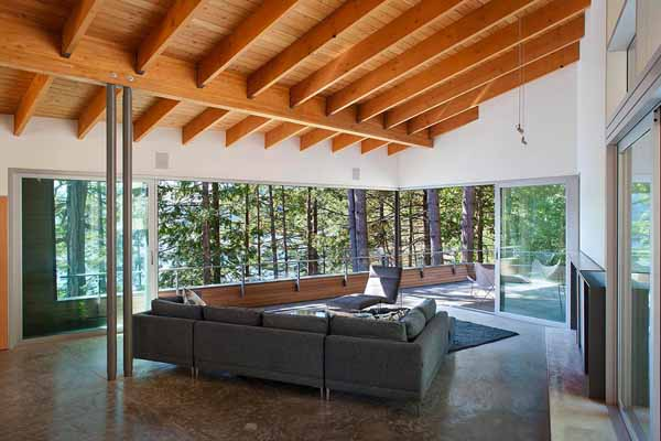 Lake House Design with Open Ceiling Beams and Large Terrace .