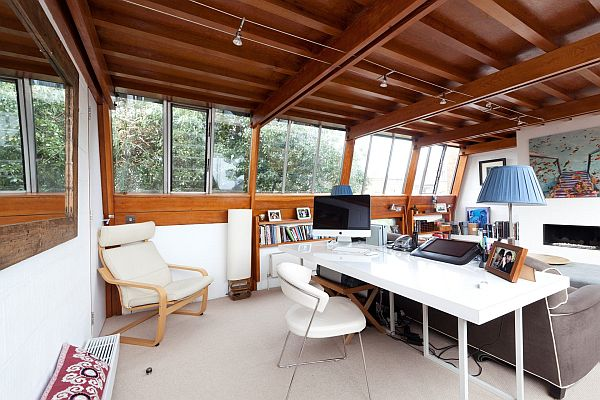 House with beautiful wooden ceiling that create a warm ambien