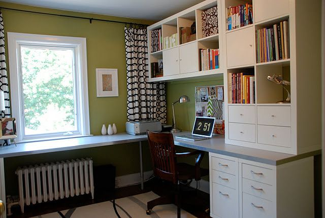 one full wall a desk/cabinet combo IKEA- craft room organization .